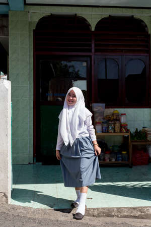 shantytown: MANADO, NORTH SULAWESI, INDONESIA - AUGUST 5, 2015: young happy muslim teenager woman on August 5, 2015 in Manado, North Sulawesi, Indonesia