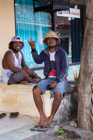 penury: PENIDA ISLAND, INDONESIA - JUNE 29.2015: Hindu men resting on street market, village Toyapakeh, Nusa Penida, Bali June 29. 2015 Indonesia