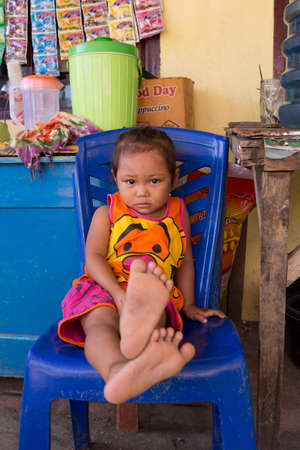 shantytown: MANADO, NORTH SULAWESI, INDONESIA - AUGUST 5, 2015: Indonesian baby in Manado shantytown on August 5, 2015 in Manado, North Sulawesi, Indonesia