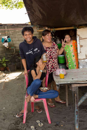 shantytown: MANADO, NORTH SULAWESI, INDONESIA - AUGUST 5, 2015: Indonesian family in shantytown on August 5, 2015 in Manado, North Sulawesi, Indonesia