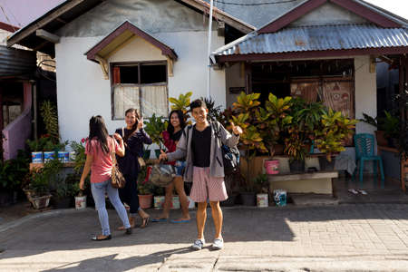 shantytown: MANADO, NORTH SULAWESI, INDONESIA - AUGUST 5, 2015: Indonesian teenagers in shantytown on August 5, 2015 in Manado, North Sulawesi, Indonesia