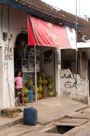nusa: PENIDA ISLAND, INDONESIA - JUNE 29.2015: Hindu girl at the street market, village Toyapakeh, Nusa Penida, Bali June 29. 2015 Indonesia Editorial
