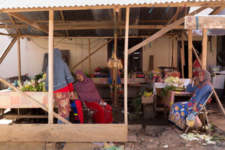 shantytown: MANADO, NORTH SULAWESI, INDONESIA - AUGUST 5, 2015: Indonesian muslim womans in small street market on August 5, 2015 in Manado, North Sulawesi, Indonesia