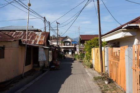 beggary: MANADO, NORTH SULAWESI, INDONESIA - AUGUST 5, 2015:  Manado shantytown street on August 5, 2015 in Manado, North Sulawesi, Indonesia