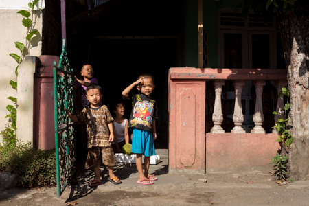shantytown: MANADO, NORTH SULAWESI, INDONESIA - AUGUST 5, 2015: Indonesian children in Manado shantytown on August 5, 2015 in Manado, North Sulawesi, Indonesia
