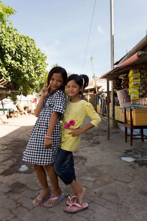 shantytown: MANADO, NORTH SULAWESI, INDONESIA - AUGUST 5, 2015: Indonesian girls in Manado shantytown on August 5, 2015 in Manado, North Sulawesi, Indonesia