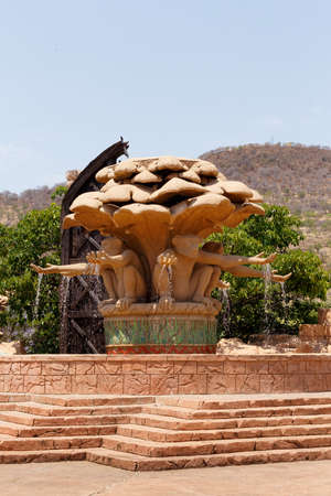 lost city: Gigantic monkey statues on fountain near bridge in famous Lost City in Sun City, South Africa