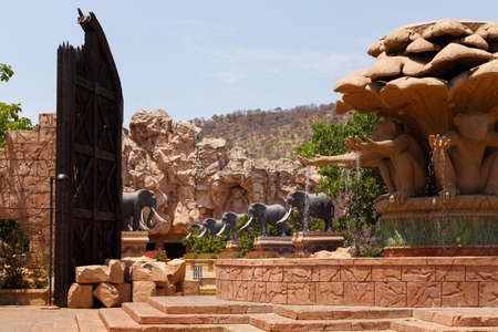 lost city: Gigantic elephant statues on fluttering Bridge of Time in famous resort Lost City in Sun City, South Africa