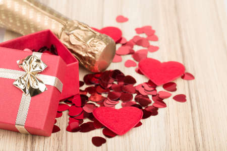 love symbols: Valentines day: bottle of vine, red hearts and small present Stock Photo