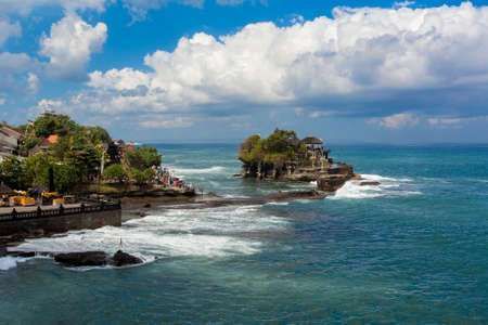bali: famous Tanah Lot Temple on Sea in Bali Island Indonesia with blue sky and waves