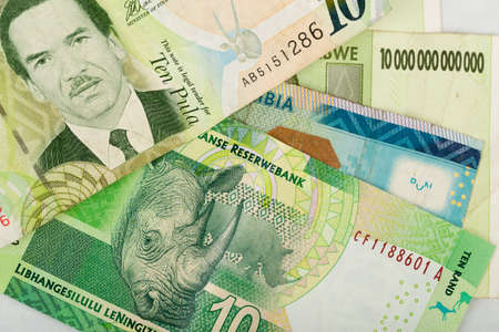 trillion: South african countries banknotes for background. Botswana pula, Namibian dollar, South Africa rand and Zimbabwe dollars.