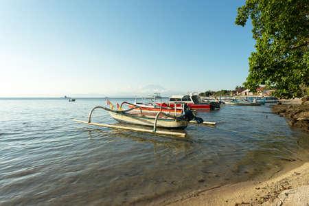 nusa: sand beach with boat, Bali Indonesia, Nusa Penida island with blue sky Stock Photo