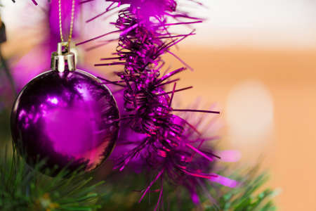 the detail: detail of decorated christmas tree with violet balls