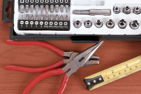 toolset: DIY work tools, screwdriver toolbox with set of bits, pliers and measuring tape