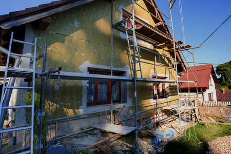 repaired: repaired rural house, fixed facade, insulation and painted to green  color witg swimming pool