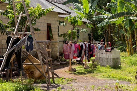 beggary: Washed clothes drying outside of an old rural house, Bali, Nusa penida, Indonesiahouse