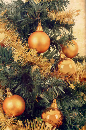 decorated christmas tree: yellow decorated christmas tree with balls and ribbon