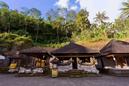 archaeological complex: Gnung Kawi Temple. Gunug Kawi is an ancient temple situated in Pakerisan River, near Tampaksiring village in Bali. The archaeological complex is carved out of the living rock, dating to 11th century.