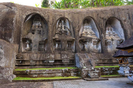 archaeological complex: unung Kawi Temple. Gunug Kawi is an ancient temple situated in Pakerisan River, near Tampaksiring village in Bali. The archaeological complex is carved out of the living rock, dating to 11th century.