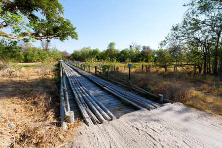okavango delta: wooden bridge over Okavango swamps, Kwai region, Okavango Delta, Botswana