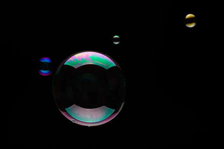 black backgound: Soap bubbles on a black backgound for overlay use