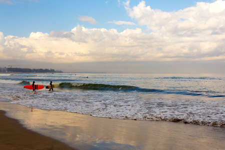 morning on Kuta beach in Bali Indonesia with surfers