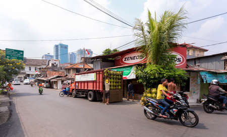 shantytown: JAKARTA - August 10: Ordinary peoples on shantytown street in Jakarta. August 10, 2015 in Jakarta, Indonesia.