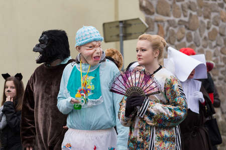 attend: PUKLICE, CZECH REPUBLIC - JANUARY 13, 2016: People attend the Masopust Carnival, a traditional ceremonial door-to-door procession in small village. January 13, 2016 in Puklice, Czech Republic