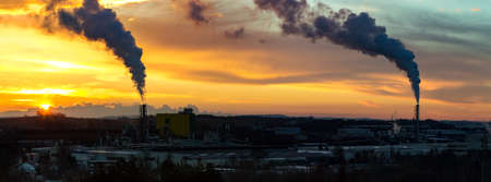 polution: Sunrise silhouette of city landscape with smoking factory, ecology pollution concept