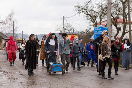 ceremonial: PUKLICE, CZECH REPUBLIC - JANUARY 13, 2016: People attend the Masopust Carnival, a traditional ceremonial door-to-door procession in small village. January 13, 2016 in Puklice, Czech Republic