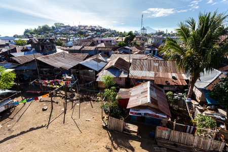 indigence: poor houses with sheet tin by the river, Kota Manado, North Sulawesi, Indonesia