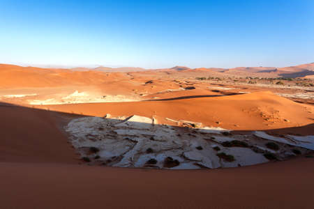 shaddow: top viev of beautiful sunrise landscape of hidden Dead Vlei in Namib desert with blue sky, this is best place of Namibia
