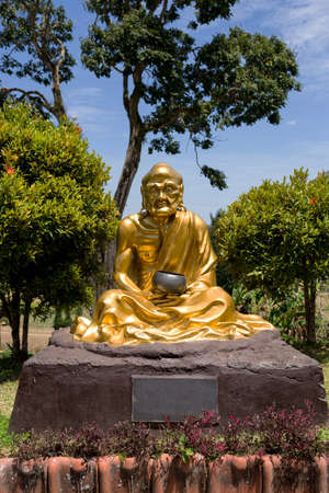 sulawesi: SULAWESI, INDONESIA - AUGUST 8.2015:, Buddhistic fat monk statue in complex Pagoda Ekayana, north Sulawesi,August 8. 2015 Sulawesi, Indonesia