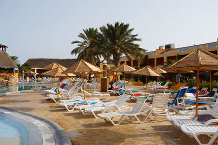 swimm: BORJ CEDRIA, TUNISIA - AUGUST 5:  Luxury tunisian tourist resort hotel Carribean World beach on August 5, 2014 in Borj Cedria, Tunisia.