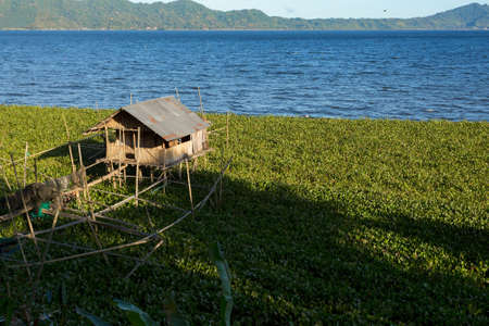 destitute: Fish farm and hatchery or nursery, Lake Tondano, Sulawesi, Indonesia (Celebes), Asia Editorial