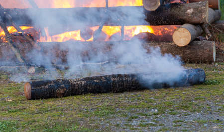 christian festival: detail of walpurgis night fire, religion christian festival, burning fire wood, traditional burning witches on stake with huge flames Stock Photo