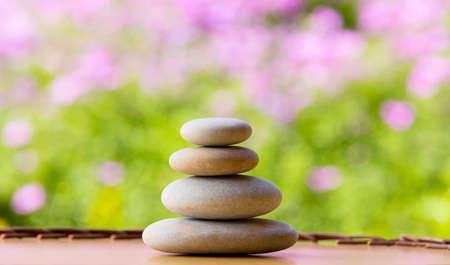 balancing zen pebble stones outdoor, spa wellness tranquil scene, soul equanimity concept, mental calmness, abstract retro colors