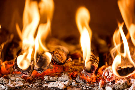closeup of Flame in a fireplace, flames and burning woods Stock Photo