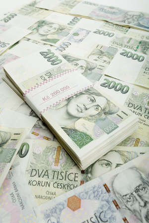 approximately: czech banknotes nominal value two and five thousand crowns. 300 000 Kc is approximately 12 450 US dollars (USD) or 11 100 Euro (EUR)