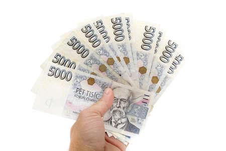 抱きかかえたチェコの銀行券公称値 5000 王冠白い背景に分離します。 写真素材 - 65107642