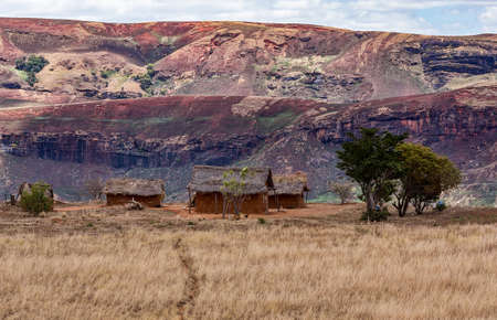 destitution: Traditional Madagascar hill landscape with malagasy huts. Deforestation in Madagascar creates agricultural or pastoral land but can also result ecology problem with soil and water. Mahajanga Province, Madagascar