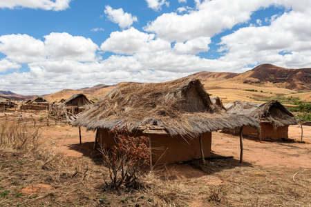 Traditional Madagascar vilage Mahatsinjo in hill. Deforestation in Madagascar creates agricultural or pastoral land but can also result ecology problem with soil and water. Mahajanga Province, Madagascar Stock Photo