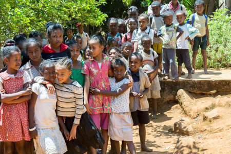 developing country: MADAGASCAR OCTOBER 17.2016: Malagasy school children waiting for a lesson in afternoon break, Toamasina Province, October 17. 2016, Madagascar