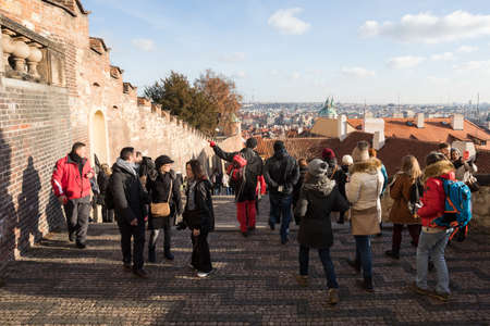antiterrorist: PRAGUE, CZECH REPUBLIC - DECEMBER 3, 2016: Tourists queue behind of the Prague Castle, due to anti-terrorist checks. December 3, 2016 Prague, Czech Republic. Editorial