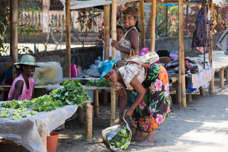 MAROANTSETRA ,MADAGASCAR OCTOBER 18.2016 Malagasy peoples on big colorful rural marketplace on main street of Maroantsetra city. Everyday ordinary life on street. Madagascar, October 18. 2016 Editorial