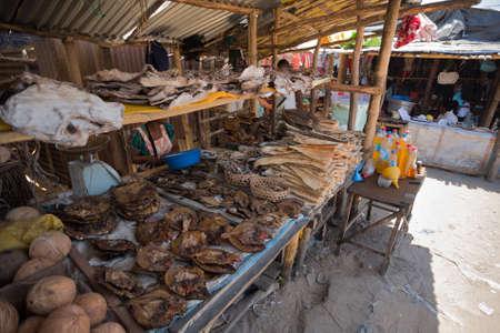 penury: MAROANTSETRA ,MADAGASCAR OCTOBER 18.2016 Malagasy peoples on big colorful rural marketplace on main street of Maroantsetra city. Everyday ordinary life on street. Madagascar, October 18. 2016 Editorial