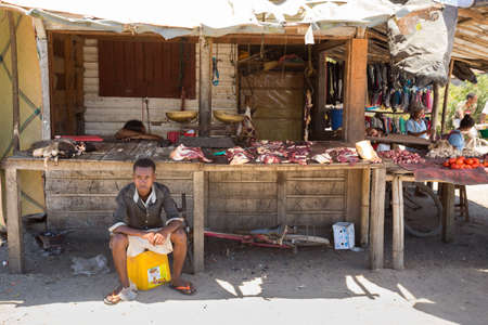 beggary: MAROANTSETRA ,MADAGASCAR OCTOBER 18.2016 Malagasy peoples on big colorful rural marketplace on main street of Maroantsetra city. Everyday ordinary life on street. Madagascar, October 18. 2016 Editorial