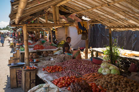 destitution: MAROANTSETRA ,MADAGASCAR OCTOBER 18.2016 Malagasy peoples on big colorful rural marketplace on main street of Maroantsetra city. Everyday ordinary life on street. Madagascar, October 18. 2016 Editorial