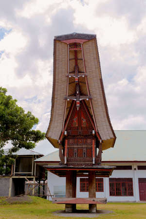 Details of outstanding local Toraja ethnic architecture, wood carvings, paintings and traditional decoration with rooster in Bitung city, North Sulawesi (celebes) Indonesia