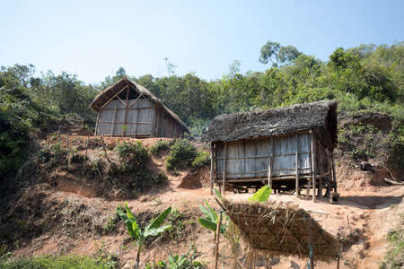 Traditional african malagasy huts in Andasibe region, typical village in Madagascar, Toamasina Province.  Stock Photo